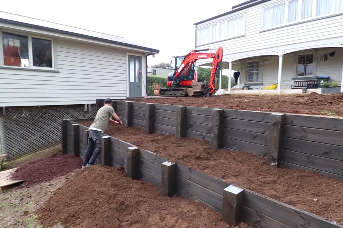brown wooden retaining wall excavator