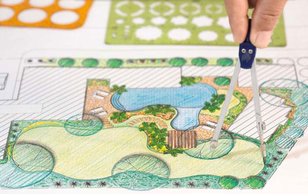 landscaping designer measuring backyard