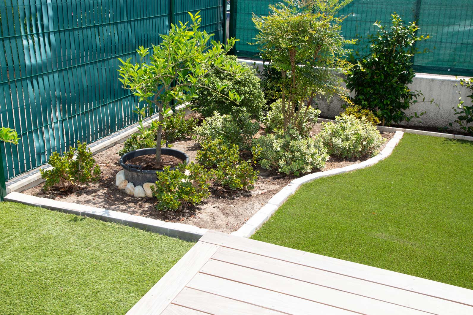 trees plants mulch synthetic turf